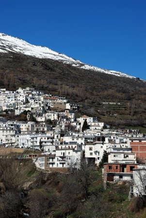 sierra snow: View of the village and snow capped mountains of the Sierra Nevada, whitewashed village  pueblo blanco , Trevelez, Las Alpujarras, Granada Province, Andalucia, Spain, Western Europe  Stock Photo