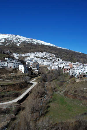 sierra snow: View of white village with snow capped mountains of the Sierra Nevada to the rear, Trevelez, Las Alpujarras, Granada Province, Andalucia, Spain, Western Europe  Stock Photo