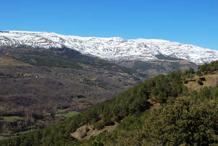 sierra snow: View over the mountainous landscape towards the snow capped Sierra Nevada, Trevelez, Las Alpujarras, Granada Province, Andalucia, Spain, Western Europe