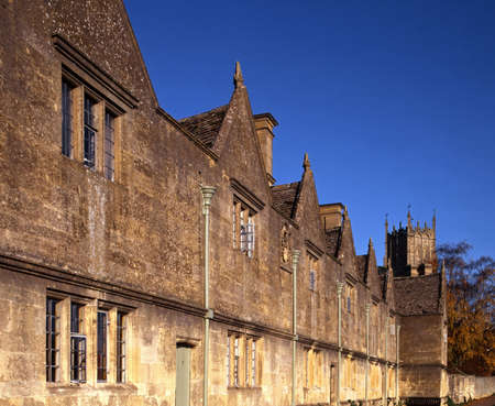 almshouse: Almshouses with St  James Church tower to rear, Chipping Campden, Gloucestershire, England, UK, Western Europe
