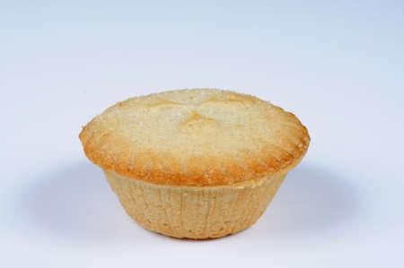 mince pie: Single mince pie against a grey background