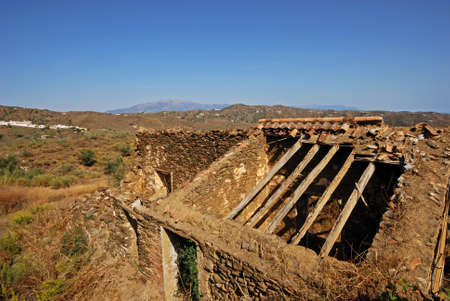 Derelict finca with village to rear, Macharaviaya, Malaga Province, Andalucia, Spain, Western Europe Stock Photo - 18789342