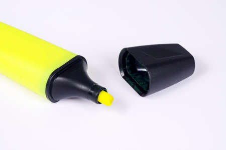 Yellow highlighter pen with cap removed against a white background