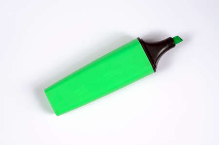 Green highlighter pen with cap removed against a white background