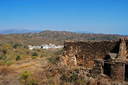 Derelict finca with village to rear,  whitewashed village (pueblo blanco), Macharaviaya, Costa del Sol, Malaga Province, Andalucia, Spain. Stock Photo - 19007646