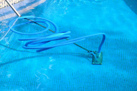 Cleaning equipment in a swimming pool, Costa del Sol, Andalucia, Spain, Western Europe