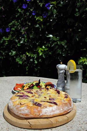 alfresco: Italian Cheese and red onion Focaccia bread with mixed salad to the rear