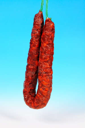 chorizos: Spanish chorizo sausage against a blue background  Stock Photo