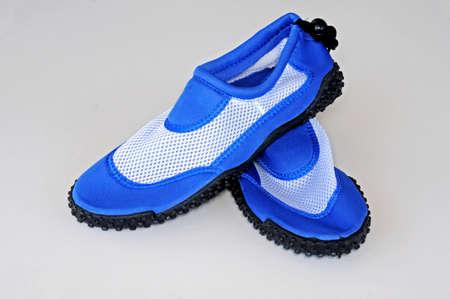 gents: Gents blue beach shoes against a plain background
