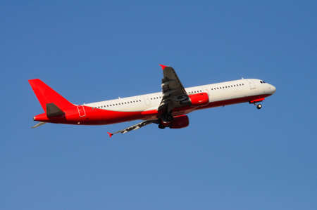 undercarriage: Airbus A-321 in flight with undercarriage down