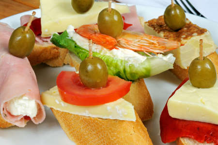 Spanish tapas selection, Prawn with cream cheese, Tortilla, Brie with red pepper, cheese and tomato, ham rolled and filled with cream cheese, ham, red pepper and cheese, all topped with a green olive and served on crusty bread, Andalusia, Spain, Western E photo