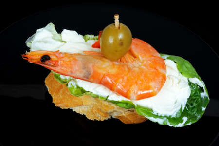 Lettuce filled with cream cheese and King prawn tapa topped with a green olive and served on crusty bread, Andalusia, Spain, Western Europe