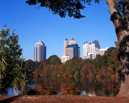 Skyscrapers, trees and lake in Piedmont Park, Atlanta, Georgia, USA  photo