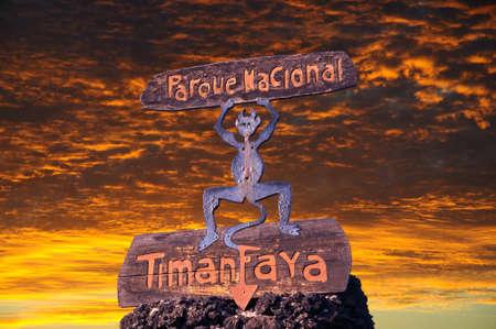 timanfaya: National Park Fire Devil emblem logo at sunset, Timanfaya National Park, Lanzarote, Canary Islands, Spain