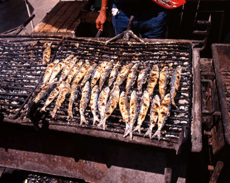 Sardines cooking at quaside restaurant, Portimao, Algarve, Portugal, Western Europe