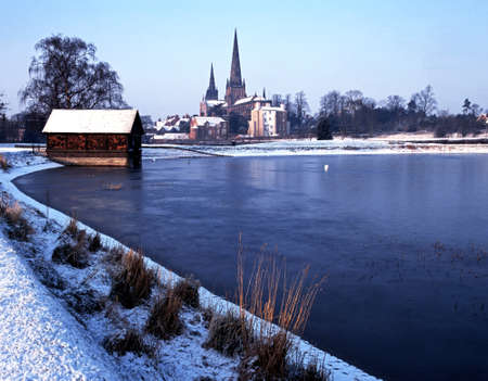 Cathedral Church of the Blessed Virgin Mary and St Chad viewed across Stowe pool on a snowy morning, Lichfield, Staffordshire, England, UK, Western Europe