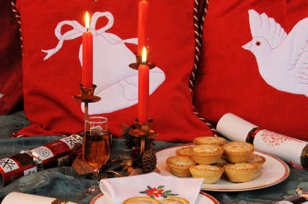 sherry: Christmas food and drink of mince pies and sherry with red candles  Stock Photo