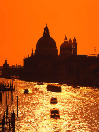 View along the Grand Canal at sunset, Venice, Veneto, Europe  photo