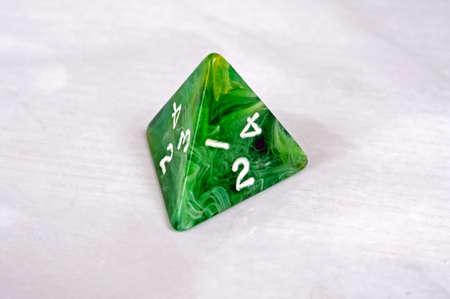 sided: Platonic 4 sided pyramic die, England, UK, Western Europe  Stock Photo