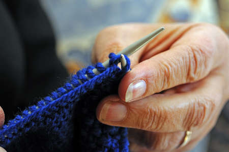 Woman knitting, England, UK, Western Europe  photo