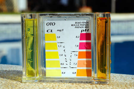 ph: Checking the chemical balance of a swimming pool, Costa del Sol, Andalucia, Spain, Western Europe  Stock Photo