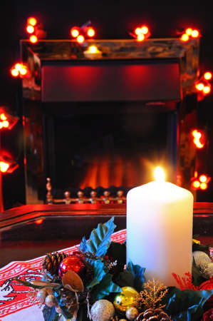 Coal effect electric fire with Christmas decorations, England, UK, Western Europe  photo