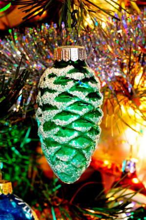 Green glass pinecone Christmas decoration hanging on a Christmas tree, England, UK, Western Europe