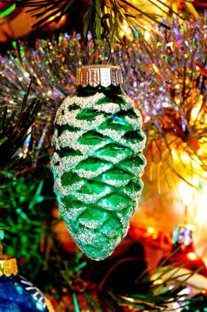 Green glass pinecone Christmas decoration hanging on a Christmas tree, England, UK, Western Europe Reklamní fotografie - 20858017