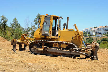 tracked: Yellow bulldozer parked on wasteland, Costa del Sol, Andalusia, Spain, Western Europe