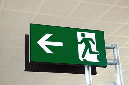 Green exit sign, Terminal three, Malaga airport, Malaga, Andalusia, Spain, Western Europe