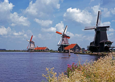 zaan: Three windmills on the banks of the river Zaan, Zaanse Schands, Holland, Netherlands, Western Europe  Stock Photo