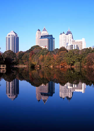 atlanta tourism: Reflections of skyscrapers in Piedmont Lake, Piedmont Park, Atlanta, Gerogia, USA
