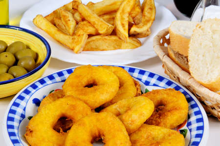calamares: Tapas, Chips  Fries , Calamares  Squid rings , Green olives and bread, Mijas Costa, Costa del Sol, Malaga Province, Andalucia, Spain, Western Europe  Stock Photo