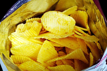 flavoursome: Looking into an open packet of crinkle cut crisps