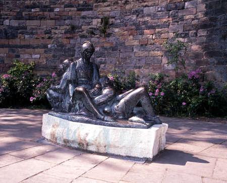friar: Robin Hood related bronze statue of Friar Tuck, Will Scarlet and Little John outside the castle, Nottingham, Nottinghamshire, England, UK, Western Europe  Stock Photo