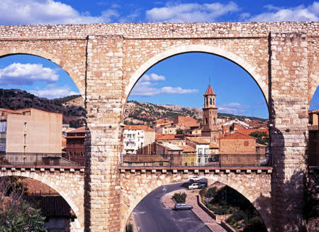 16th century: View of the Los Arcos Aqueduct with town buildings to the rear, Teruel, Teruel Province, Aragon, Spain, Western Europe
