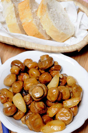 Tapas - Whole button mushrooms and garlic cloves with bread, Calypso, Costa del Sol, Malaga Province, Andalucia, Spain, Western Europe  photo