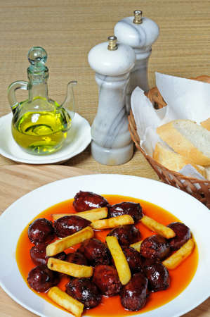 Mini chorizo sausages and chipped potatoes in olive oil tapas, Costa del Sol, Malaga Province, Andalucia, Spain, Western Europe  photo