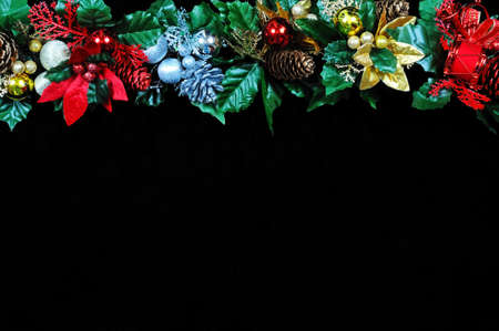 Christmas garland border on the top side of the frame against a black background