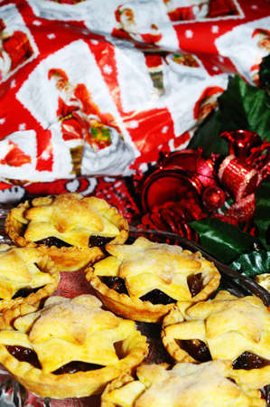 Mince pies with Christmas presents to the rear, England, UK, Western Europe