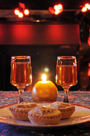 Mince pies and sherry with a candle and fireplace to the rear, England, UK, Western Europe