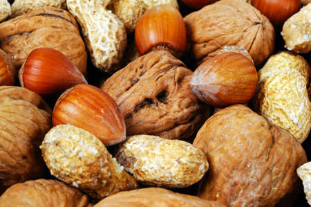 monkey nuts: Mixed nuts in their shells  Monkey nuts, Walnuts and Hazelnuts , UK, Western Europe  Stock Photo