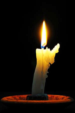 candleholders: White candle with wax running down side of candle against a black background  Stock Photo