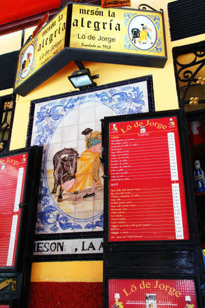 matadors: Malaga, Spain - June 14, 2011 - Tapas Bar menu and ceramic bullfighting picture, Malaga, Costa del Sol, Malaga Province, Andalucia, Spain, Western Europe  Editorial