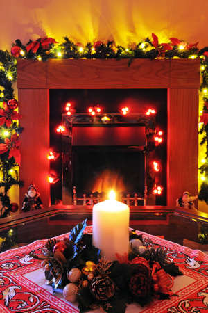 fire surround: Coal effect electric fire with Christmas decorations, England, UK, Western Europe