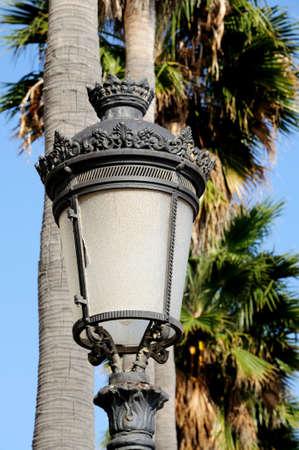 Traditional wrought iron streetlight along the promenade, Marbella, Costa del Sol, Malaga Province, Andalucia, Spain, Western Europe