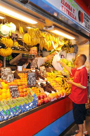 Malaga, Spain - June 14, 2011 - Fruit and vegetable stall in the indoor market  Mercado de Atarazanas , Malaga, Costa del Sol, Malaga Province, Andalusia, Spain, Western Europe