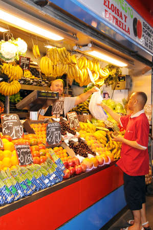 Malaga, Spain - June 14, 2011 - Fruit and vegetable stall in the indoor market  Mercado de Atarazanas , Malaga, Costa del Sol, Malaga Province, Andalusia, Spain, Western Europe