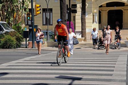 Malaga, Spain - June 14, 2011 - People at pedestrian crossing, Malaga, Costa del Sol, Malaga Province, Andalucia, Spain, Western Europe