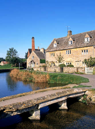 River Eye and riverside cottages leading to the old mill, Lower Slaughter, Cotswolds, Gloucestershire, England, UK, Western Europe  photo
